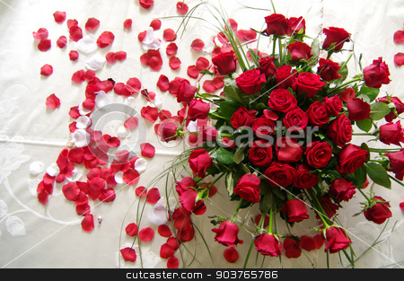 red roses for your love stock photo, a bouquet of red roses and a sea of red petals , a symbol of love , scattered on the bed of newlyweds by Piermichele Malucchi
