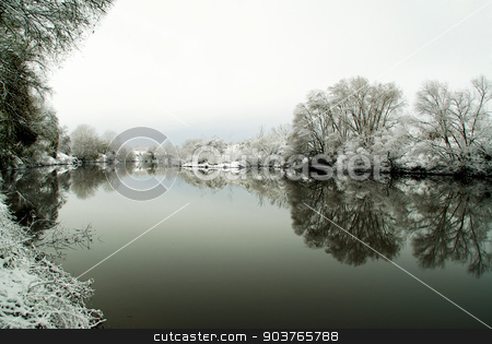 Frozen lake in winter  stock photo, Frozen lake in the woods after a snowfall winter  by Piermichele Malucchi