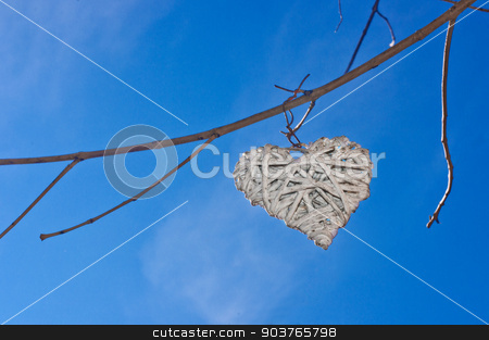 Heart in the sky  stock photo, A white heart in the blue sky hanging from a tree  by Piermichele Malucchi