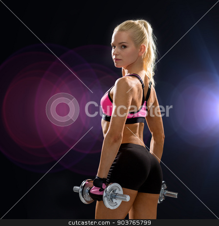 sporty woman with heavy steel dumbbells stock photo, fitness, exercising and dieting concept - sporty woman with heavy steel dumbbells from back by Syda Productions