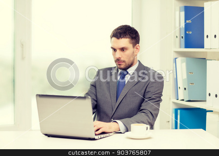 busy businessman with laptop and coffee stock photo, office, business, technology and internet concept - busy businessman with laptop computer and coffee at office by Syda Productions