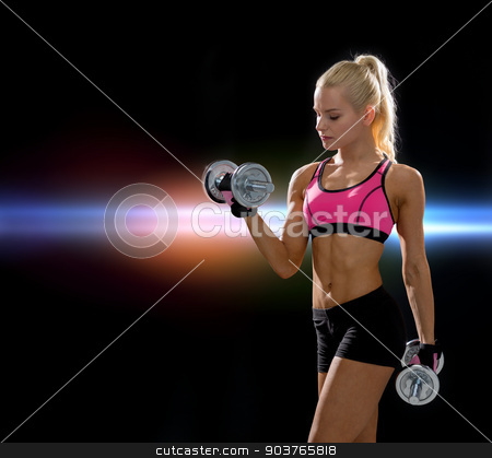 sporty woman with heavy steel dumbbells stock photo, fitness, exercising and dieting concept - sporty woman with heavy steel dumbbells by Syda Productions