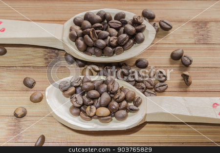 Coffee beans stock photo, Coffee beans and two wooden spoon on wooden background by Robert Boss