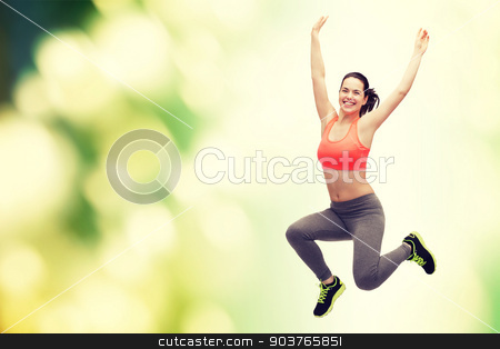 sporty teenage girl jumping in sportswear stock photo, fitness and diet concept - beautiful sporty teenage girl jumping in sportswear by Syda Productions