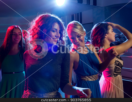 smiling friends dancing in club stock photo, party, holidays, celebration, nightlife and people concept - smiling friends dancing in club by Syda Productions
