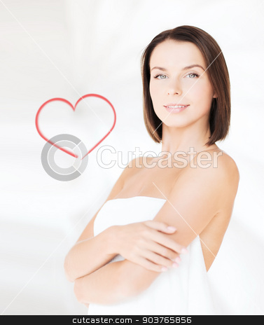 beautiful woman standing in towel stock photo, beauty, spa and people concept - beautiful woman standing in towel by Syda Productions