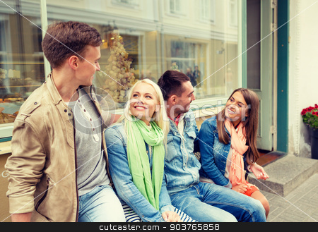 group of smiling friends walking in the city stock photo, friendship, travel and vacation concept - group of smiling friends in the city by Syda Productions