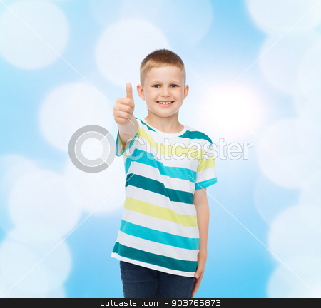 little boy in casual clothes with arms crossed stock photo, happiness, childhood and people concept - smiling little boy in casual clothes with showing thumbs up over blue background by Syda Productions