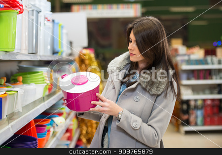 Beautiful Young Woman Shopping In A Grocery Supermarket stock photo, Beautiful Young Woman Shopping For Bowl In Produce Department Of A Grocery Store - Supermarket - Shallow Deep Of Field by Jasminko Ibrakovic