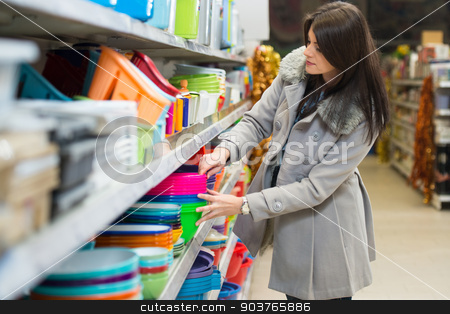 Young Woman Shopping In The Supermarket stock photo, Beautiful Young Woman Shopping For Bowl In Produce Department Of A Grocery Store - Supermarket - Shallow Deep Of Field by Jasminko Ibrakovic