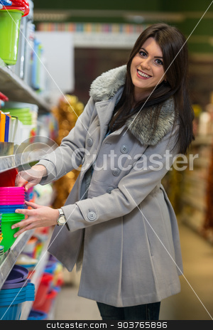 Woman Shopping In Supermarket stock photo, Beautiful Young Woman Shopping For Bowl In Produce Department Of A Grocery Store - Supermarket - Shallow Deep Of Field by Jasminko Ibrakovic