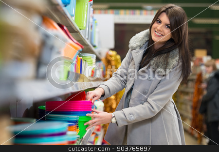 Woman Shopping At The Supermarket stock photo, Beautiful Young Woman Shopping For Bowl In Produce Department Of A Grocery Store - Supermarket - Shallow Deep Of Field by Jasminko Ibrakovic