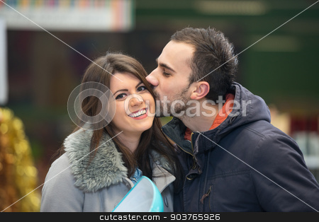 Beautiful Young Couple Shopping In A Grocery Supermarket stock photo, Beautiful Young Couple Shopping For Bowl In Produce Department Of A Grocery Store - Supermarket - Shallow Deep Of Field by Jasminko Ibrakovic