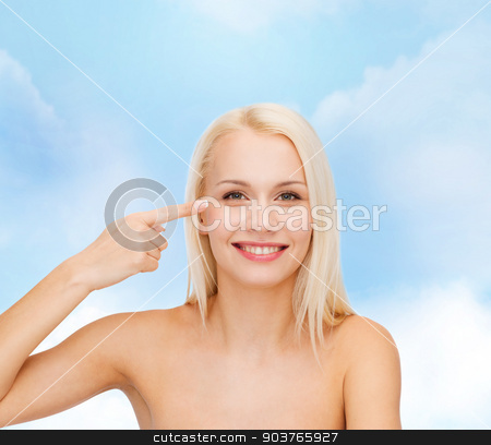 beautiful woman touching her eye area stock photo, health and beauty concept - face of beautiful woman touching her eye area by Syda Productions