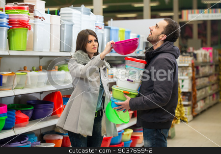 Couple At Groceries Store stock photo, Beautiful Young Couple Shopping For Bowl In Produce Department Of A Grocery Store - Supermarket - Shallow Deep Of Field by Jasminko Ibrakovic