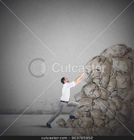 Climb the success stock photo, Tired businessman struggling to climb the success by Federico Caputo