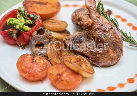 grilled duck legs stock photo, grilled duck legs with vegetables by olinchuk