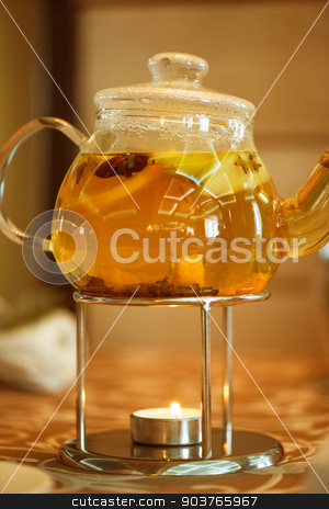 teapot of herbal tea stock photo, teapot of herbal tea on table  by olinchuk