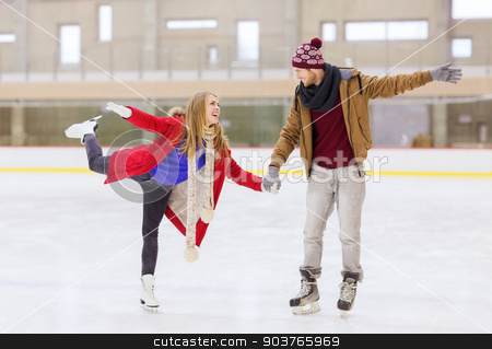 happy couple holding hands on skating rink stock photo, people, friendship, sport and leisure concept - happy couple holding hands on skating rink by Syda Productions