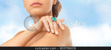 closeup of woman hand with big blue cocktail ring stock photo, wedding, bridal jewelry and luxury concept - close up of beautiful woman hand with big blue cocktail ring by Syda Productions