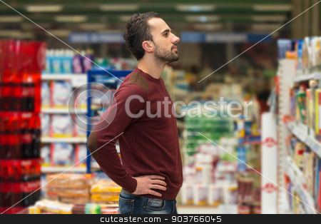 Handsome Young Man Shopping In A Grocery Supermarket stock photo, Handsome Young Man Shopping For Fruits And Vegetables In Produce Department Of A Grocery Store - Supermarket - Shallow Deep Of Field by Jasminko Ibrakovic