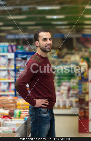Man At Groceries Store stock photo, Handsome Young Man Shopping For Fruits And Vegetables In Produce Department Of A Grocery Store - Supermarket - Shallow Deep Of Field by Jasminko Ibrakovic
