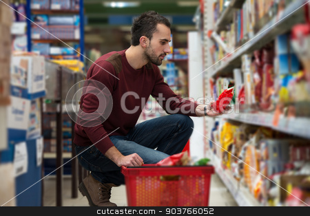 Man Shopping At The Supermarket stock photo, Handsome Young Man Shopping For Fruits And Vegetables In Produce Department Of A Grocery Store - Supermarket - Shallow Deep Of Field by Jasminko Ibrakovic