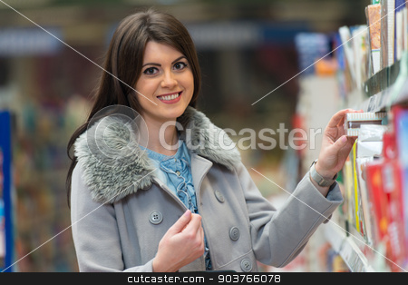 Woman Shopping At The Supermarket stock photo, Beautiful Young Woman Shopping For Fruits And Vegetables In Produce Department Of A Grocery Store - Supermarket - Shallow Deep Of Field by Jasminko Ibrakovic
