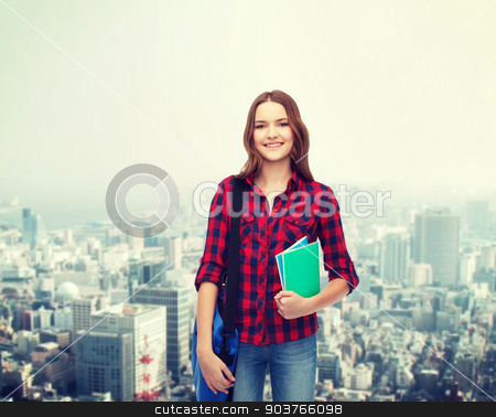 smiling female student with bag and notebooks stock photo, education and people concept - smiling female student with laptop bag and notebooks by Syda Productions