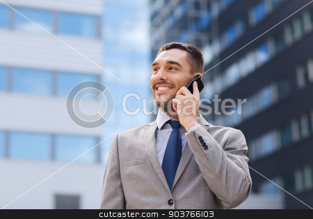 smiling businessman with smartphone outdoors stock photo, business, technology and people concept - smiling businessman with smartphone talking over office building by Syda Productions