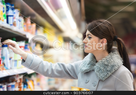 Beautiful Young Woman Shopping In A Grocery Supermarket stock photo, Beautiful Young Woman Shopping For Fruits And Vegetables In Produce Department Of A Grocery Store - Supermarket - Shallow Deep Of Field by Jasminko Ibrakovic