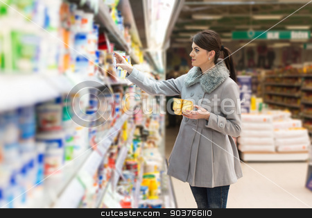 Woman At Groceries Store stock photo, Beautiful Young Woman Shopping For Fruits And Vegetables In Produce Department Of A Grocery Store - Supermarket - Shallow Deep Of Field by Jasminko Ibrakovic