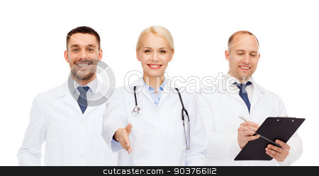 group of doctors making handshake gesture stock photo, healthcare, people and medicine concept - group of doctors with stethoscope and clipboard making handshake gesture by Syda Productions