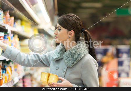 Young Woman Shopping In The Supermarket stock photo, Beautiful Young Woman Shopping For Fruits And Vegetables In Produce Department Of A Grocery Store - Supermarket - Shallow Deep Of Field by Jasminko Ibrakovic