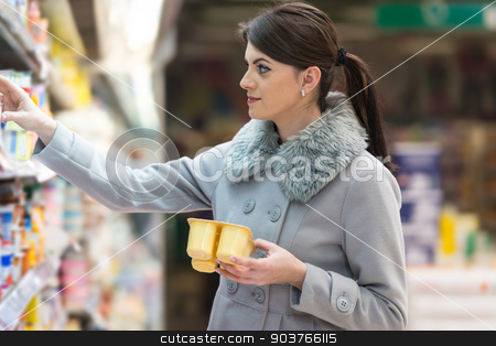 Woman Shopping In Supermarket stock photo, Beautiful Young Woman Shopping For Fruits And Vegetables In Produce Department Of A Grocery Store - Supermarket - Shallow Deep Of Field by Jasminko Ibrakovic