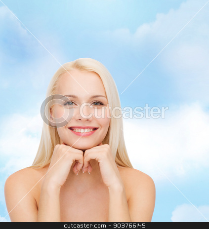 smiling young woman stock photo, beauty, spa and health concept - smiling young woman by Syda Productions