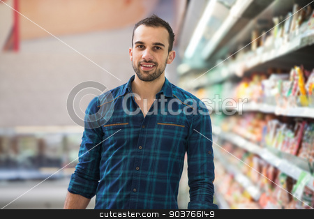 Man Shopping In Supermarket stock photo, Handsome Young Man Shopping For Fruits And Vegetables In Produce Department Of A Grocery Store - Supermarket - Shallow Deep Of Field by Jasminko Ibrakovic