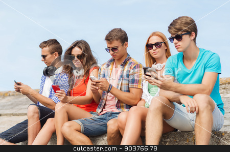 group of friends with smartphones outdoors stock photo, friendship, summer, technology and people concept - group of friends with smartphones and headphones outdoors by Syda Productions