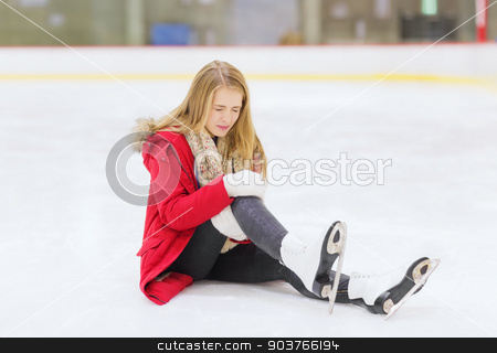 young woman fell down on skating rink stock photo, people, sport, trauma, pain and leisure concept - young woman fell down on skating rink and holding to her knee by Syda Productions