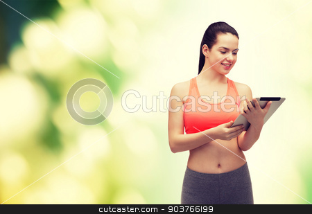 sporty woman with tablet pc computer stock photo, sport, excercise, technology, internet and healthcare - sporty woman with tablet pc computer by Syda Productions