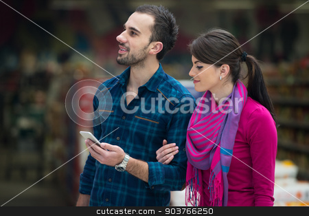Couple At Groceries Store stock photo, Beautiful Young Couple Shopping For Fruits And Vegetables In Produce Department Of A Grocery Store - Supermarket - Shallow Deep Of Field by Jasminko Ibrakovic