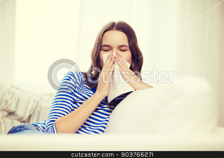 sick teenage girl with paper tissue stock photo, healthcare, medicine and home concept - sick teenage girl with paper tissue by Syda Productions