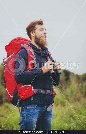 smiling man with backpack and binocular outdoors stock photo, adventure, travel, tourism, hike and people concept - smiling man with red backpack and binocular outdoors by Syda Productions