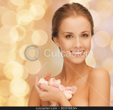 beautiful smiling young woman with flowers stock photo, beauty, people and health concept - beautiful smiling young woman with flowers and bare shoulders over beige lights background by Syda Productions