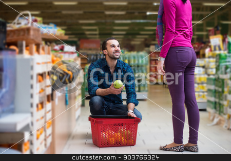 Beautiful Young Couple Shopping In A Grocery Supermarket stock photo, Beautiful Young Couple Shopping For Fruits And Vegetables In Produce Department Of A Grocery Store - Supermarket - Shallow Deep Of Field by Jasminko Ibrakovic