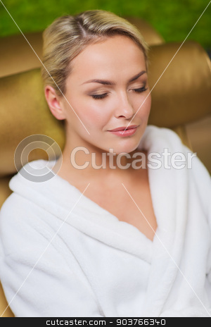 close up of woman sitting in bath robe at spa stock photo, people, beauty, healthy lifestyle and relaxation concept - close up of beautiful young woman resting on chair in bath robe at spa by Syda Productions