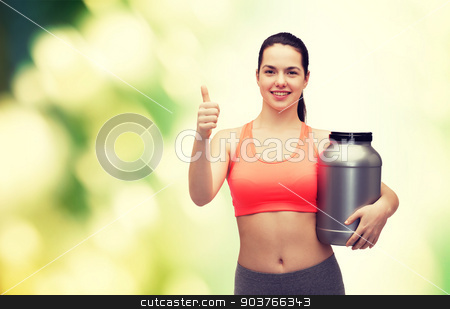 teenage girl with jar of protein showing thumbs up stock photo, fitness and diet concept - smiling teenage girl with jar of protein showing thumbs up by Syda Productions
