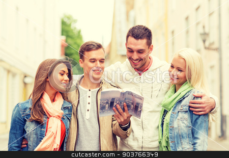 group of friends with city guide exploring town stock photo, travel, vacation and friendship concept - group of smiling friends with city guide exploring town by Syda Productions
