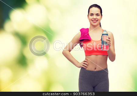sporty woman with towel and water bottle stock photo, sport, exercise and healthcare - sporty woman with pink towel and water bottle by Syda Productions