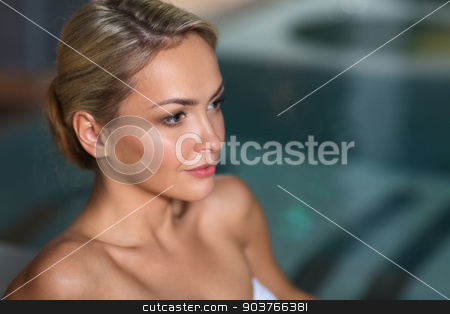 close up of woman in swimsuit at swimming pool stock photo, people, beauty, spa, healthy lifestyle and relaxation concept - close up of beautiful young woman in swimsuit at swimming pool by Syda Productions